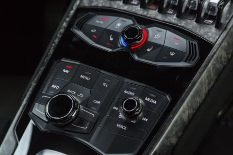 Climate controls are blissfully simple, located along with the infotainment-system controls on the Lambo's jetplane-esque central console.