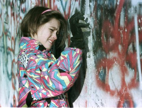 Even days later, citizens wanted to participate in the destruction. Here, a young West German girl hammers the Berlin Wall November 19.