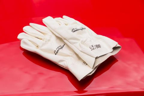 For example, a pair of white leather Lamborghini-branded gloves.