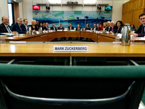 The committee left an empty chair for Zuckerberg.