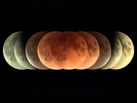 A total lunar eclipse, or blood moon, as seen in a time-lapse series of images.