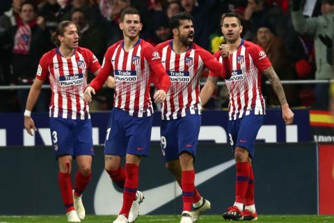 Jugadores del Atlético celebran un gol