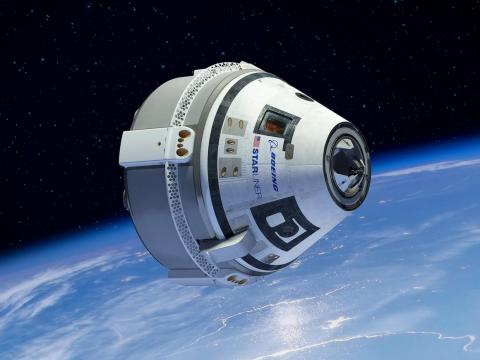 An illustration of Boeing's CST-100 Starliner spaceship flying around Earth.