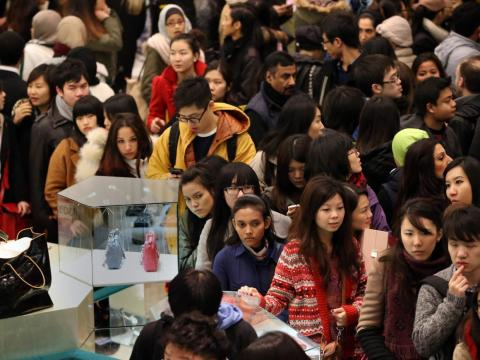 Millions of shoppers spill into stores, such as department stores in London, in hopes of finding bargains.