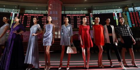 Models showcase Ellassay on the trading floor of the Shanghai Stock Exchange April 22, 2015 in Shanghai, China.