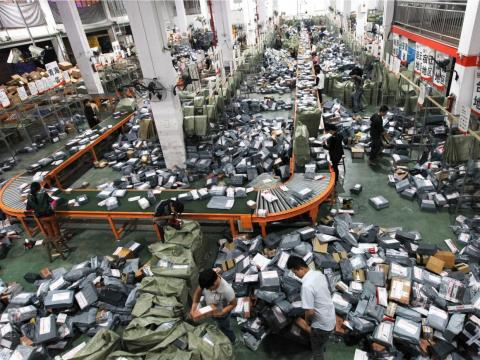Packages await delivery at an unnamed Chinese distribution center