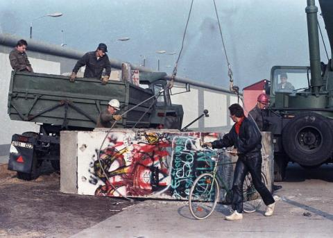 Parts of the Berlin Wall were loaded onto trucks at Potsdamer Platz by November 14.