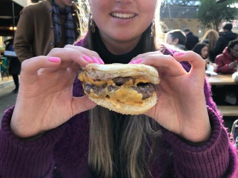 Writer Rachel Hosie flipping her burger upside down.