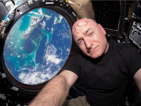 Scott Kelly snaps a selfie from the Earth-viewing Cupola module on the International Space Station.