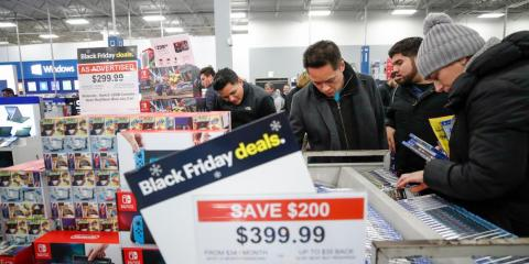 Shoppers at a Best Buy store looking for Black Friday deals.