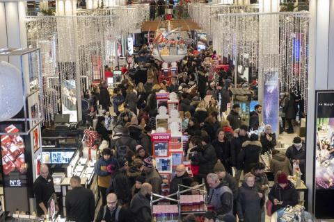Shoppers at Macy's on Thanksgiving Day in search of early Black Friday deals.