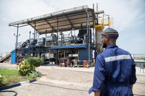 Technician Idrissa Coulibaly walks to the Janicki Omni Processor in Dakar, Senegal on September 25, 2018.