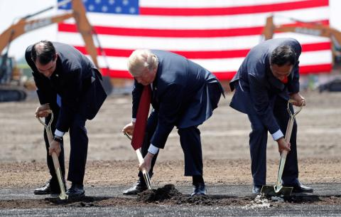 President Donald Trump taking part in a groundbreaking with Gov. Scott Walker of Wisconsin and Foxconn's chairman, Terry Gou, during a visit to Foxconn's new site in Mount Pleasant, Wisconsin.