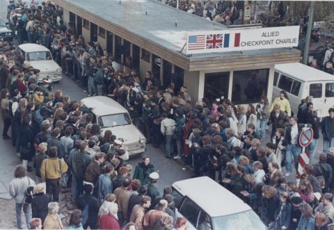 West Germans applauded as East Berlin citizens traveled through Checkpoint Charlie on the following day, November 10.
