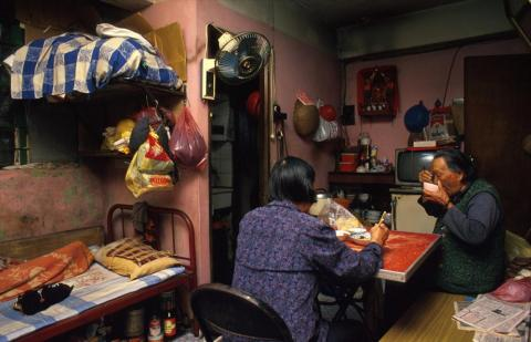 According to Girard, the Walled City had a village culture because of the tight living and working quarters. 90-year-old Law Yu Yi lived with her son's wife in a cramped third-floor apartment. It is typical for women to look after