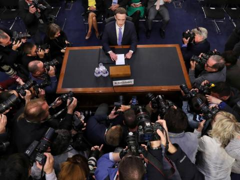APRIL: Facebook CEO Mark Zuckerberg stares down a scrum of the world's media during his appearance in Congress.