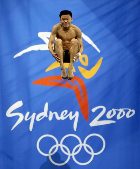 Chinese diver Hu Jia competed at the 2000 Summer Olympics in Sydney with a perfectly-positioned dive.