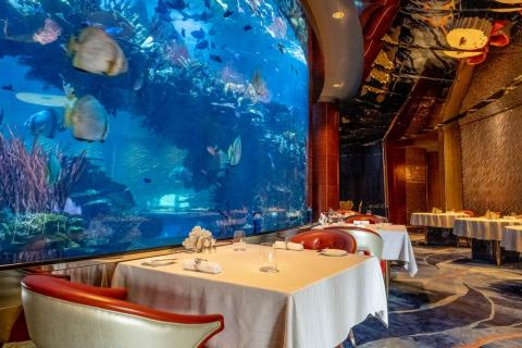 The dining room of Al Mahara wraps around a floor-to-ceiling 260,000-gallon aquarium filled with fish (not the ones you'll be eating). The staff have taken to naming the fish, like a goofy-looking Napoleon fish known as George.