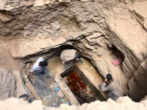 In Egypt, archaeologists opened a 30-ton black sarcophagus and found three skeletons — amid raw sewage.