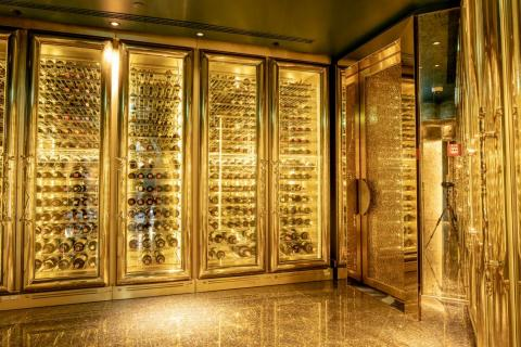 """Like everything else in the Burj, the Al Mahara wine racks do, in fact, glitter with gold. It's in spots like this where my brain is caught between """"Can only gold be a design aesthetic?"""" and """"Ooh, sparkly wall!"""""""