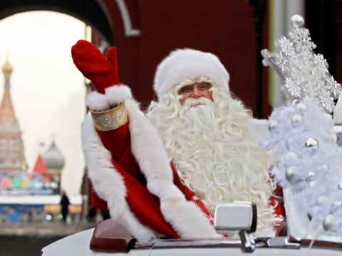 In this Friday, Dec. 26, 2008 file photo, Father Frost, the Russian equivalent to Santa Claus, waves during a welcome ceremony near Red Square