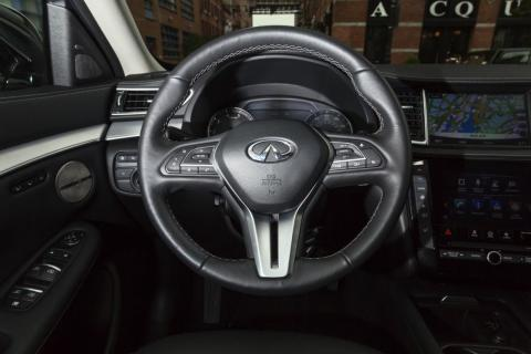 In front of the driver is a button-heavy, but well-designed leather-wrapped steering wheel.