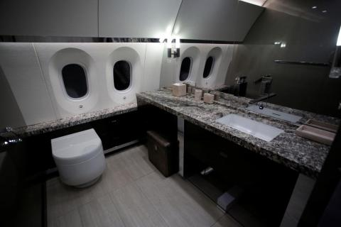 Here is a look at a restroom on the plane complete with stone countertops.