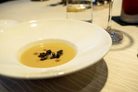 Before I even had the chance to order, the water brought over an amuse-bouche —that's a small, complimentary hors d'œuvre — of butternut squash soup. The mellow soup was brought alive by smoked pumpkin seeds and slivers of briny