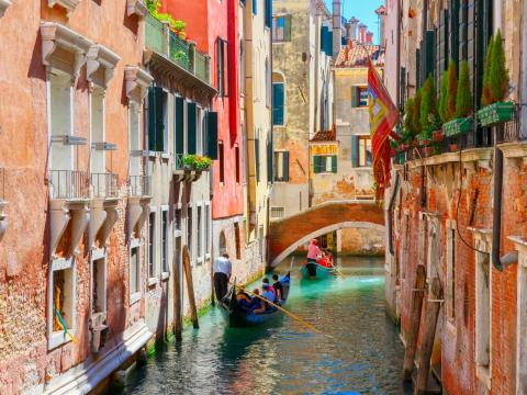 It's known for its picturesque canals and the gondolas that can be seen gliding through them ...