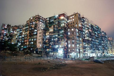 Kowloon Walled City was a densely populated, ungoverned settlement in Kowloon, an area north of Hong Kong Island. What began as a Chinese military fort evolved into a squatters' village comprising a mass of 300 interconnected high
