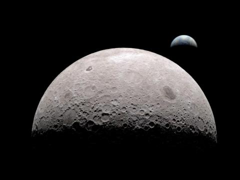A simulated view of the moon from its far side with Earth in the background.