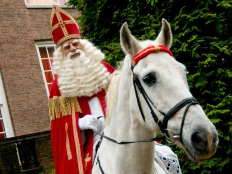 Sinterklaas rides on his horse outside the Het Loo Palace in the Netherlands.