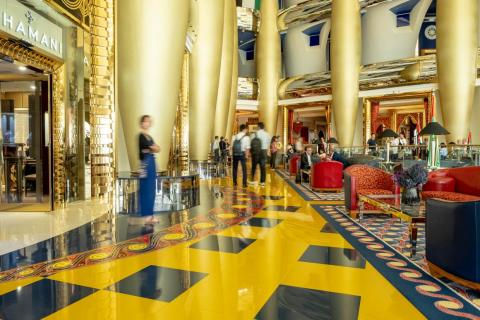 The over-the-top grandeur of the Burj hit me as I entered the atrium. It's not just the gold, though there's plenty of that, but the deep color of the saffron and ultramarine tiles and the ornate furniture.