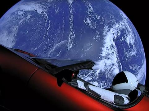 """The payload on that Falcon Heavy rocket was Musk's red Tesla Roadster, complete with a dummy driver and a note on the dash: """"DON'T PANIC!"""""""