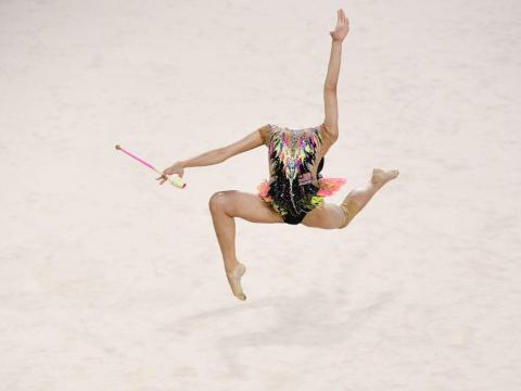 Rhythmic gymnast Izzah Amzan of Malaysia also appears momentarily headless in this photo by William West.