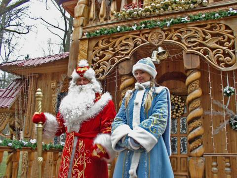 Ded Moroz poses with the Snow Maiden at a Christmas festival in Russia.