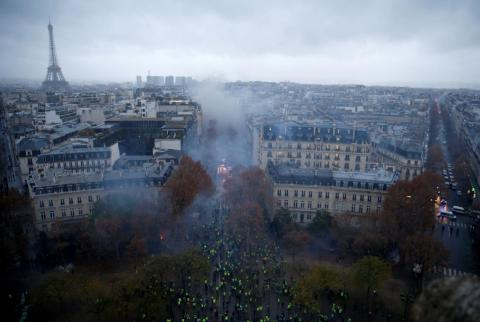 Saturday's protests took over central Paris. Here, demonstrators are pictured at the Place de l'Etoile.
