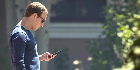 SUN VALLEY, ID - JULY 13: Mark Zuckerberg, chief executive officer of Facebook, checks his phone during the annual Allen & Company Sun Valley Conference, July 13, 2018 in Sun Valley, Idaho. Every July, some of the world's most