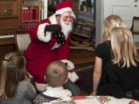 Tomte visits children in a Swedish home on Christmas Eve.