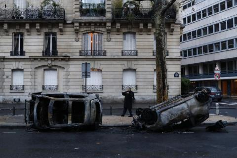 Those surveying the damage on Sunday found that the protests left burned cars and smashed stores in several of the wealthiest neighborhoods of Paris.