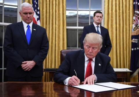 Trump signs an executive order in 2017.