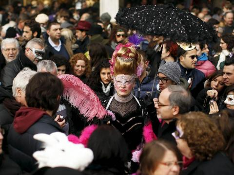 The two-week long event brings thousands of people to the city each year to don masks and costumes and party in the streets.