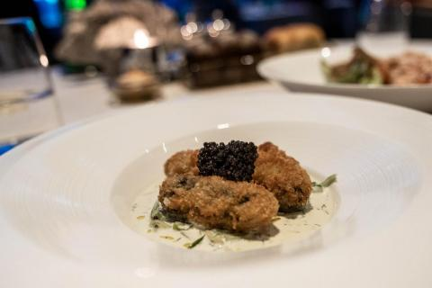 "While Brunt described Outlaw's ""pared-down"" approach as intact at Al Mahara, the dishes I encountered, while delicious, were often as over-the-top as a golden elevator. For example, the crispy oysters (260 AED, or $70) were not"