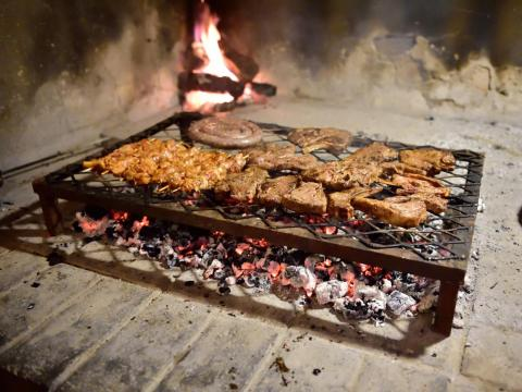 "She also suggests visitors ""sneak a proper braai experience with locals"" during your trip. A braai involves lots of meat being cooked over an open flame."