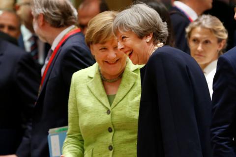 Angela Merkel y Theresa May en un encuentro en Bruselas.