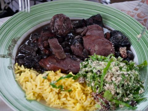 "According to TripSavvy, feijoada — a stew of beans and meat — is ""Brazil's national dish"" and a must-have in Rio de Janeiro."