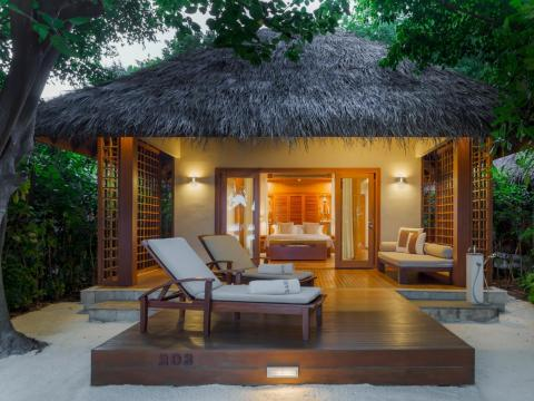 ... all of which come with a private deck, beach sun loungers, an in-villa bar, deluxe bathrobes and slippers, yoga mats, a pillow menu, an outdoor rain shower, Wi-Fi, and a TV with a surround-sound system.