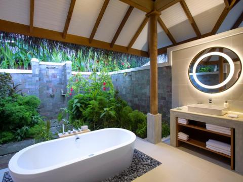 ... and luxurious open-air bathrooms. Rates for Deluxe Villas start at $370 per night for two people in the low season, and $870 in the high season.