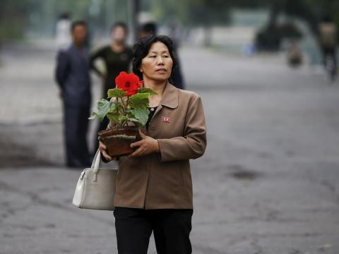 And this woman just bought a flower.