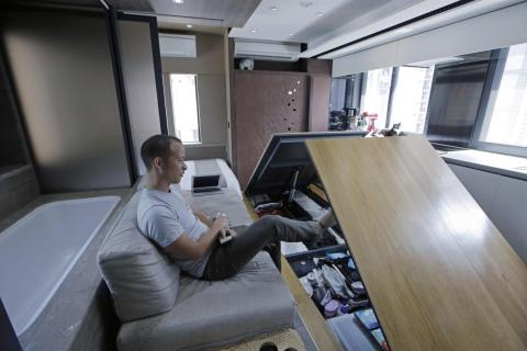 Andy Knight reveals hidden storage compartments in his Hong Kong microapartment.